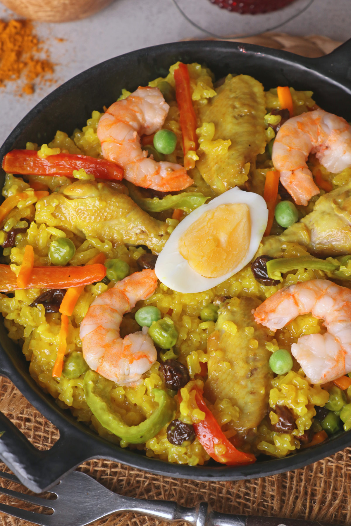Arroz Valenciana or Bringhe is a flavorful all-in-one Filipino dish from glutinous rice cooked in coconut milk and seasoned with Turmeric or yellow ginger. | www.foxyfolksy.com