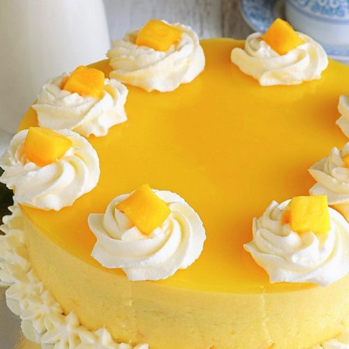 Try this Mango Cake recipe for a cool, not-too-sweet and with a touch of tanginess treat. A perfect balance of flavors that you will surely love. | www.foxyfolksy.com