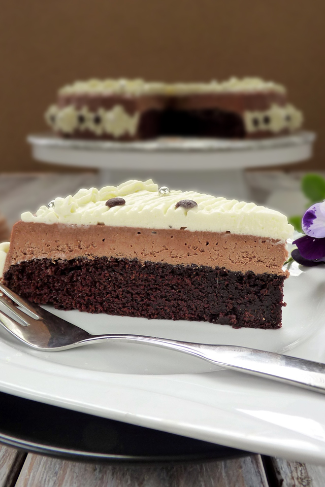 You will surely love this easy Chocolate Mousse Cake Recipe. Moist chocolate cake with a light and creamy chocolate mousse and whipped cream! | www.foxyfolsy.com