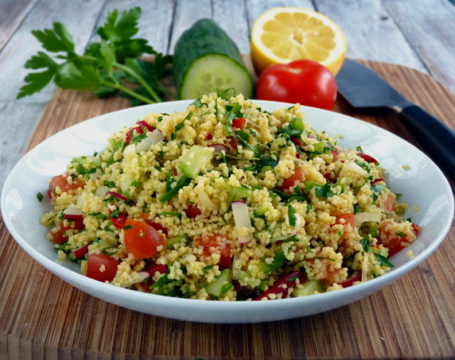Looking for something healthy? Tabbouleh, a Levatine vegetarian dish made of bulgur , tomatoes, onions, parsley and mint, seasoned with lemon juice, olive oil, salt and pepper. This is my version of this easy but healthy salad using couscous. | www.foxyfolsy.com
