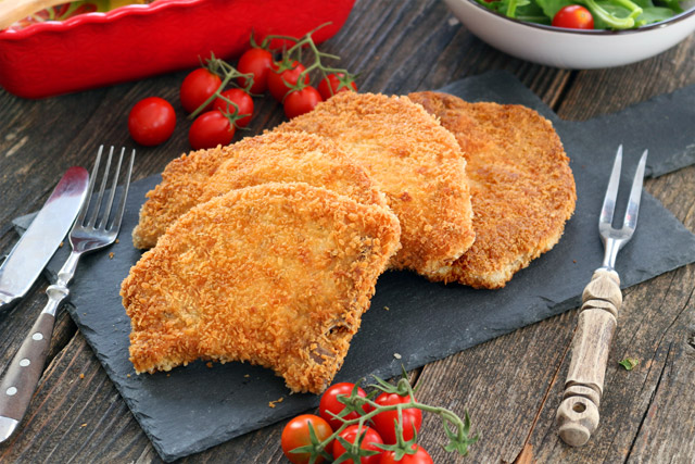 Fried Breaded Pork Chops with crunchy breaded coating and juicy meat inside.