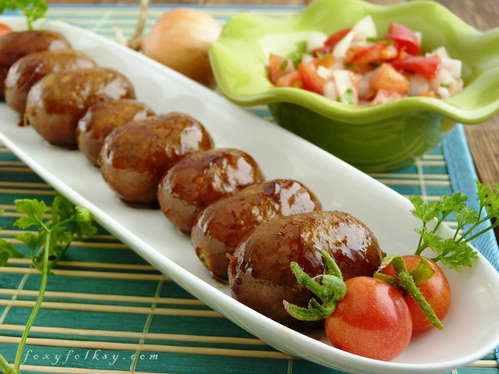 Longanisa is popular among Filipinos served at breakfast. Try this simple longganisa recipe that can be encased in a sausage casing or simply skinless. | www.foxyfolksy.com