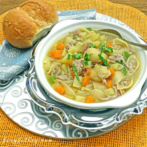 A simple recipe for vegetable soup with meat and noodles added to keep you warm and healthy this cold season. | www.foxyfolksy.com