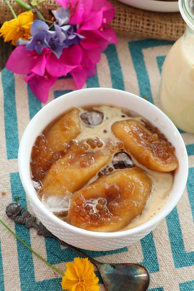 Minatamis na Saging with ice, tapiocal pearls and milk in a bowl