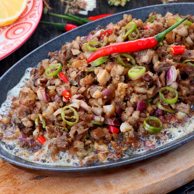 Authentic Kapampangan Sisig recipe using pork belly | Foxy Folksy