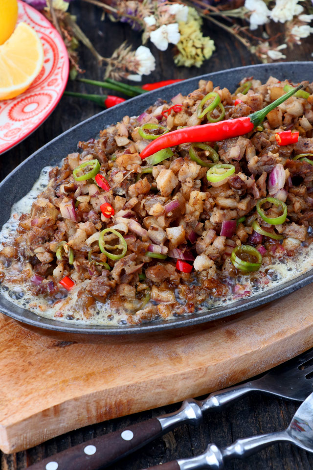 Sizzling sisig on a sizzling plate