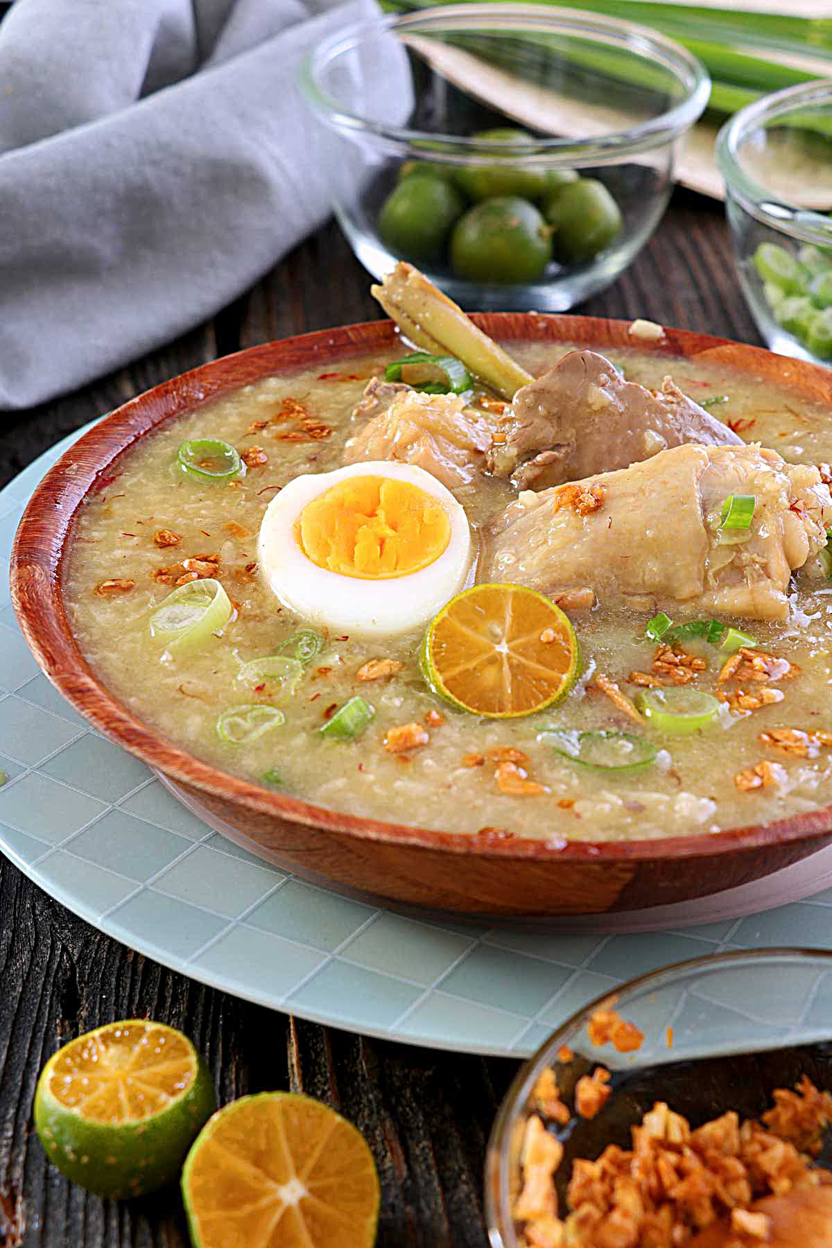 Chicken Arroz Caldo with egg, chicken liver, lemongrass, ginger, and crispy garlic