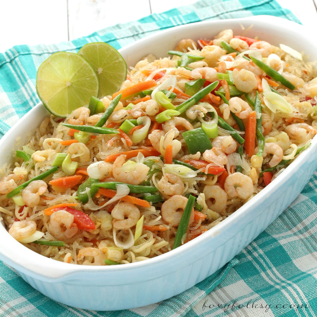 Try this easy Pancit Bihon recipe, an all time favorite Filipino dish made from rice vermicelli noodles, shrimps and mixed vegetables. | www.foxyfolksy.com
