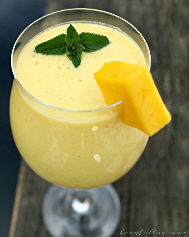 Try this creamy yummy Mango Lassi recipe, an Indian subcontinental drink that is basically a smoothie from ripe mangoes, yogurt and some spices. | www.foxyfolksy.com