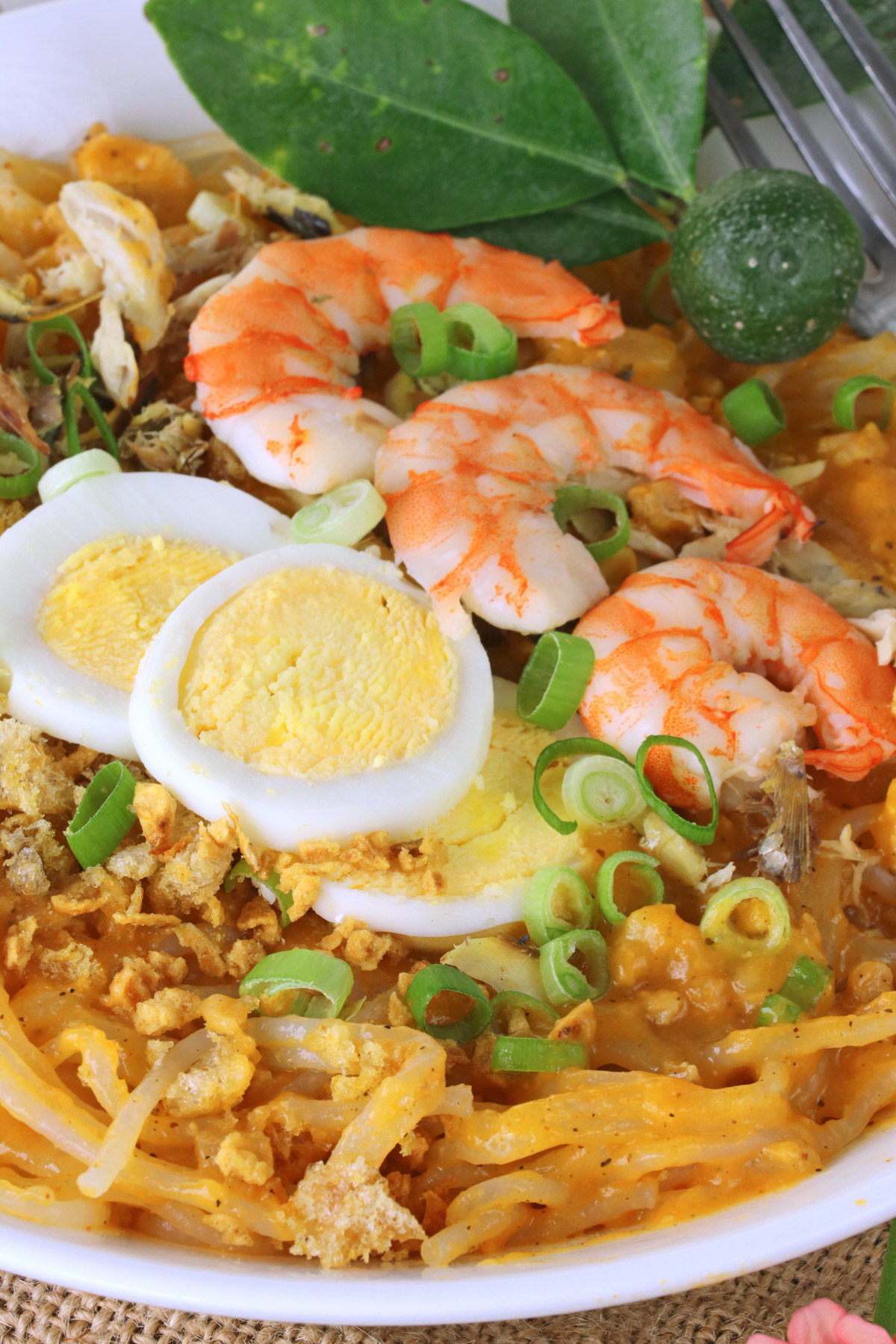 rice noodle with orange savory sauce, eggs, and shrimp