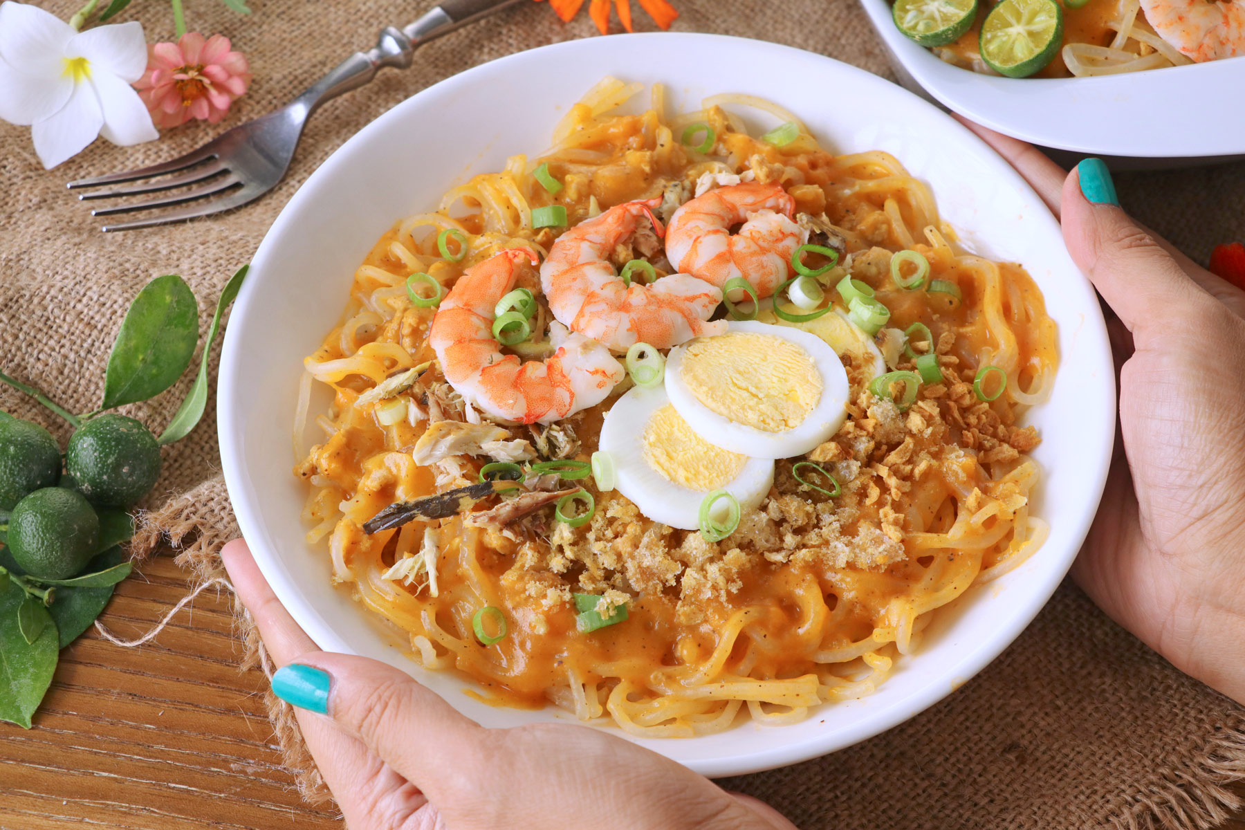 Rice noodle with savory yellow-orange sauce, shrimp and eggs