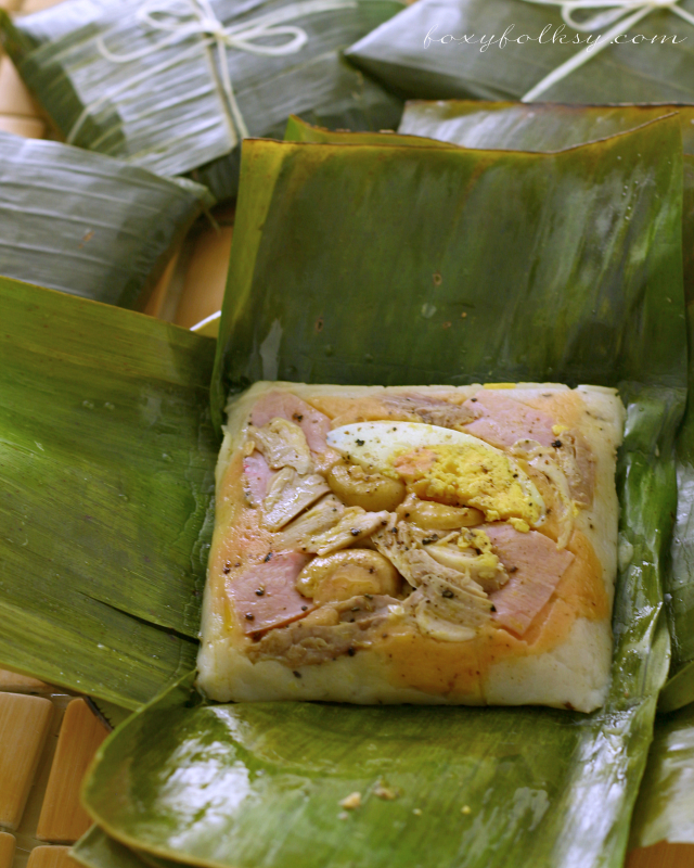 Filipino Tamales is made of ground rice, coconut milk and various toppings like chicken, ham, nuts and egg. Try this Kapampangan rice dish delicacy recipe. | www.foxyfolksy.com