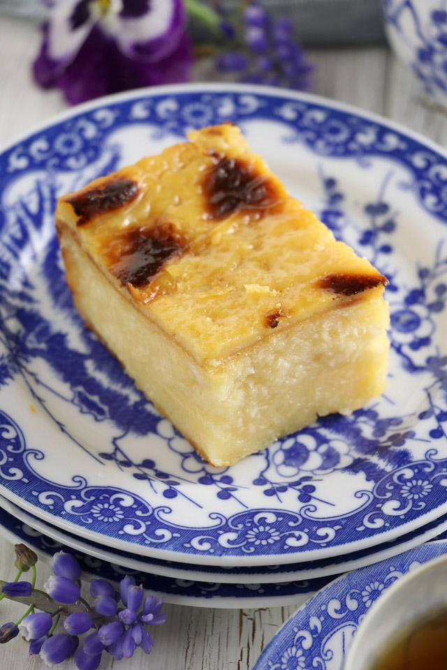 Try this easy Cassava cake recipe with creamy custard topping . A Filipino sweet delicacy from cassava/manioc. | www.foxyfolksy.com
