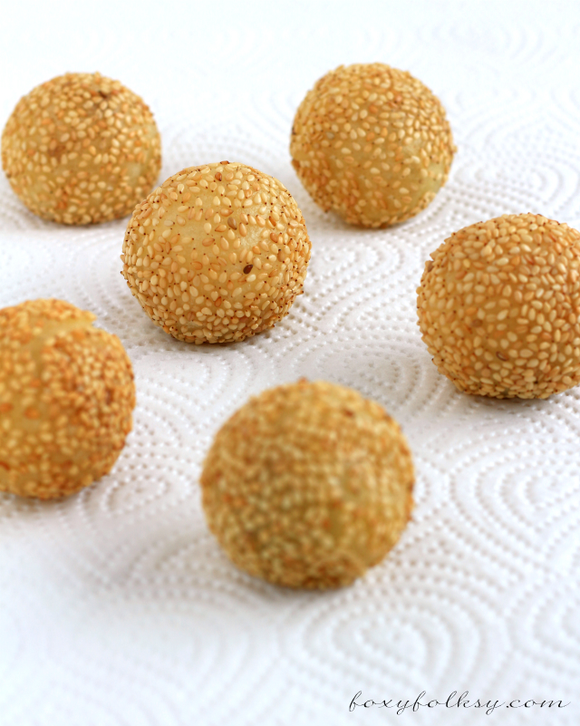 Buchi are fried glutinous rice balls filled with red bean paste rolled in sesame seeds. This Buchi recipe has extra ingredient for a crispier Buchi! | www.foxyfolksy.com