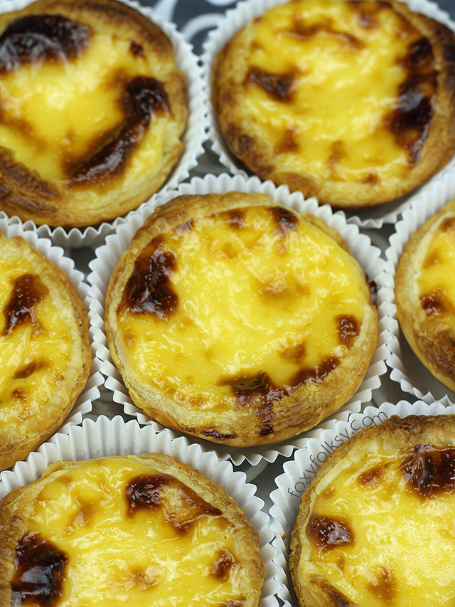 Try this Pastel de Nata or Portuguese Egg Tarts recipe, light and smooth egg custard with crisp flaky puff pastry. | www.foxyfolksy.com