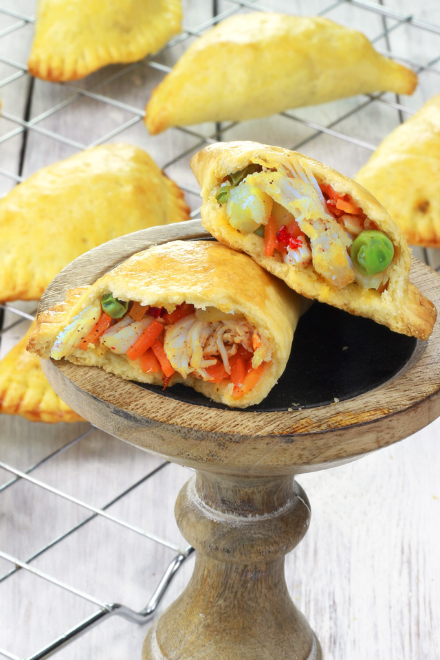 Baked Empanadas with shredded chicken, green peas, potatoes, carrots and onions in flaky crust