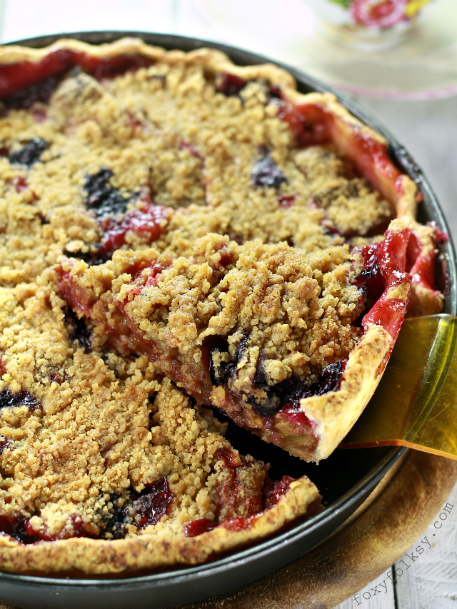 This rhubarb pie is the bomb! Exploding with tartness and sweetness in every bite. Serve it topped with whipped or ice cream and it is irresistible. | www.foxyfolksy.com
