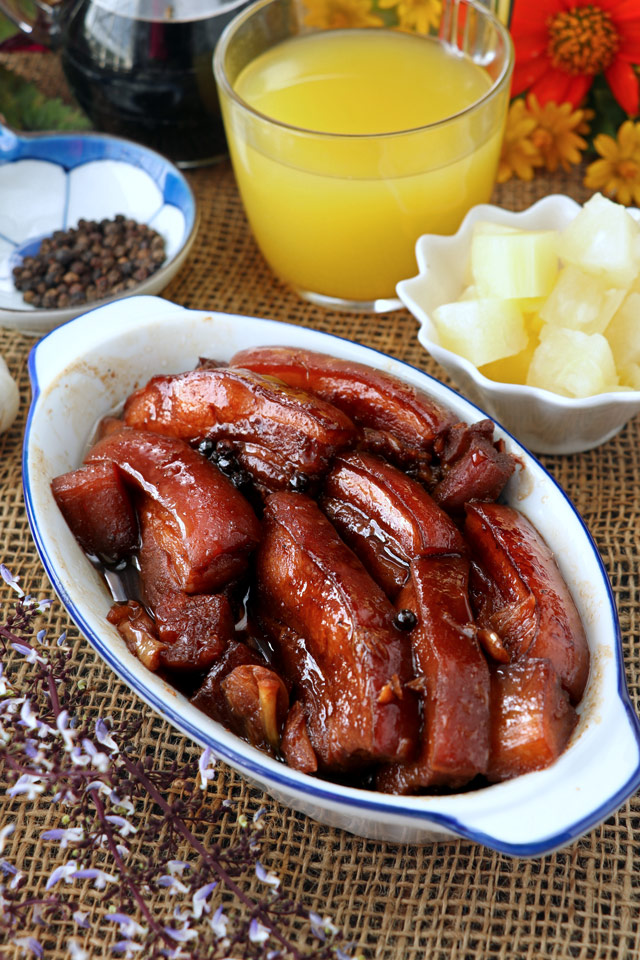 Pork Belly cooked in soy sauce, pineapple juice and spices until melt-in-your-mouth tnder.