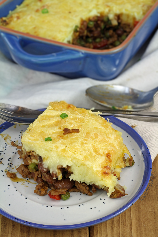 Try this easy chili Shepherd's Pie recipe. A favorite complete all-in-one meal that is done in a jiffy! | www.foxyfolksy.com