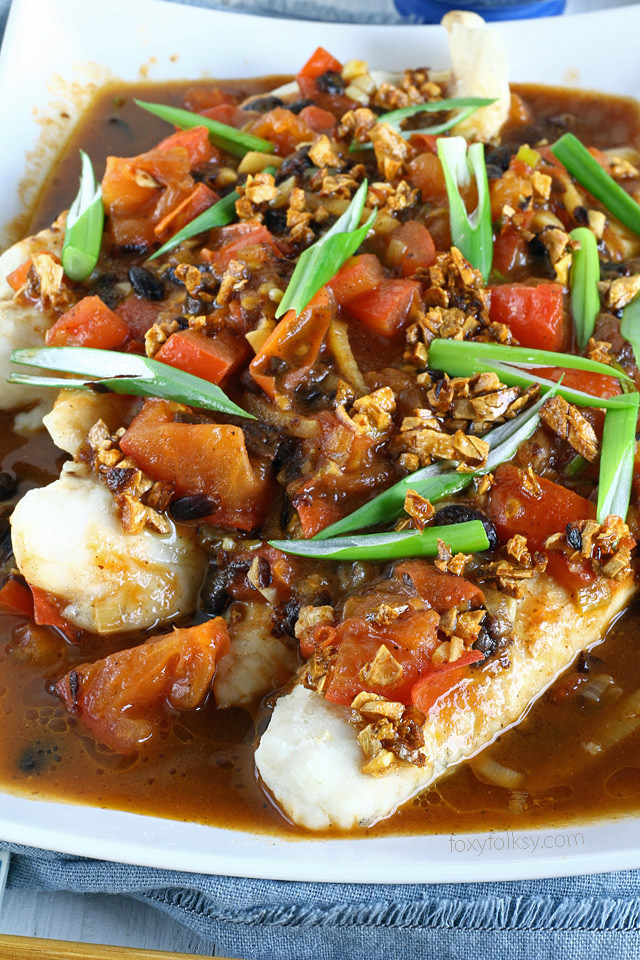 Ty this savory recipe of steamed fish with black bean sauce or Tausi. | www.foxyfolksy.com