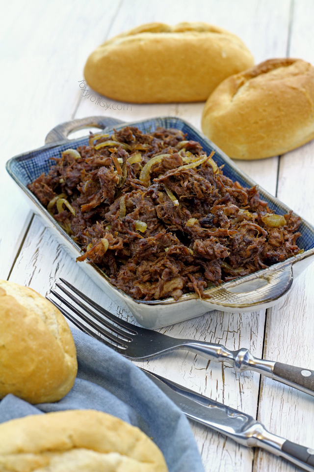 Try this simple pulled beef Asado recipe that is literally slow cooked until so tender without using any fancy slow cooker. | www.foxyfolksy.com