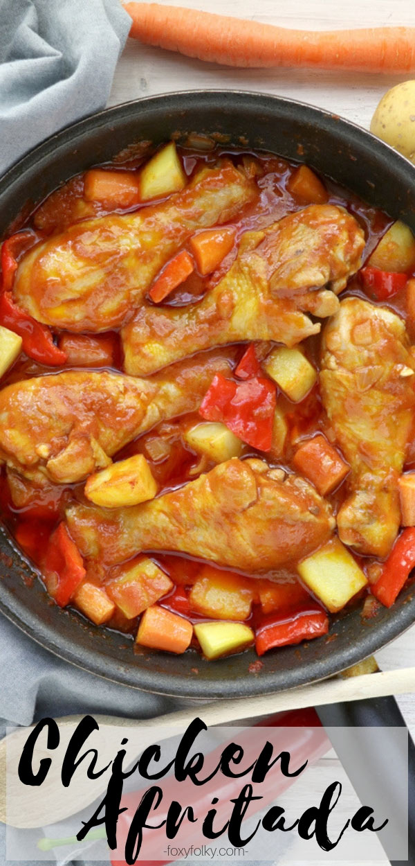 Try this Chicken Afritada recipe. A Filipino chicken stew in tomato sauce with carrots, potatoes and bell peppers. Simply delicious! | www.foxyfolksy.com #chicken #stew #tomatosauce #filipinofood