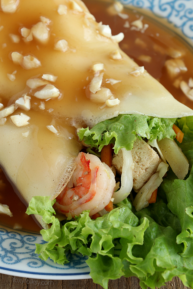 Get this recipe for Lumpiang Sariwa. A kind of Filipino Spring Rolls that is filled with various vegetables, sweet potato, shrimps and meat. Wrapped in a crepe-like wrapper and covered with a special sweet savory sauce. |www.foxyfolksy.com