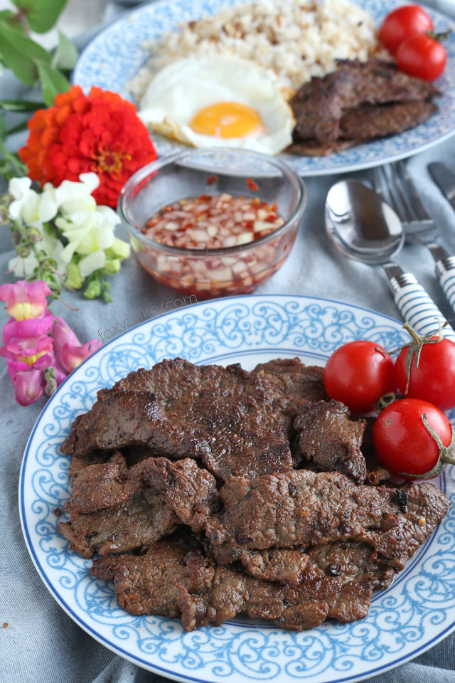 Beef tapa is a type of cured meat of thin slices of tender beef. A popular breakfast that is usually served with a sunny-side up egg and fried rice.   www.foxyfolksy.com