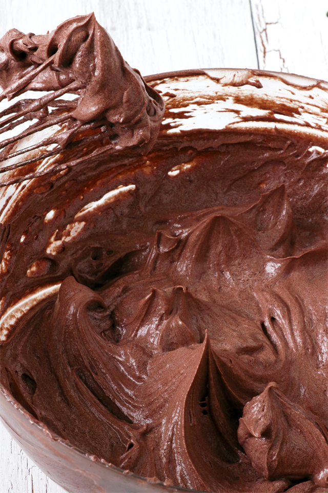 Try this Chocolate Buttercream Frosting. No powdered sugar needed. It is so light and fluffy and smoother than the classic American Buttercream Frosting. It is a bit more work but definitely easier than Swiss Meringue Frosting. It is easily the best buttercream frosting I've tried. | www.foxyfolksy.com