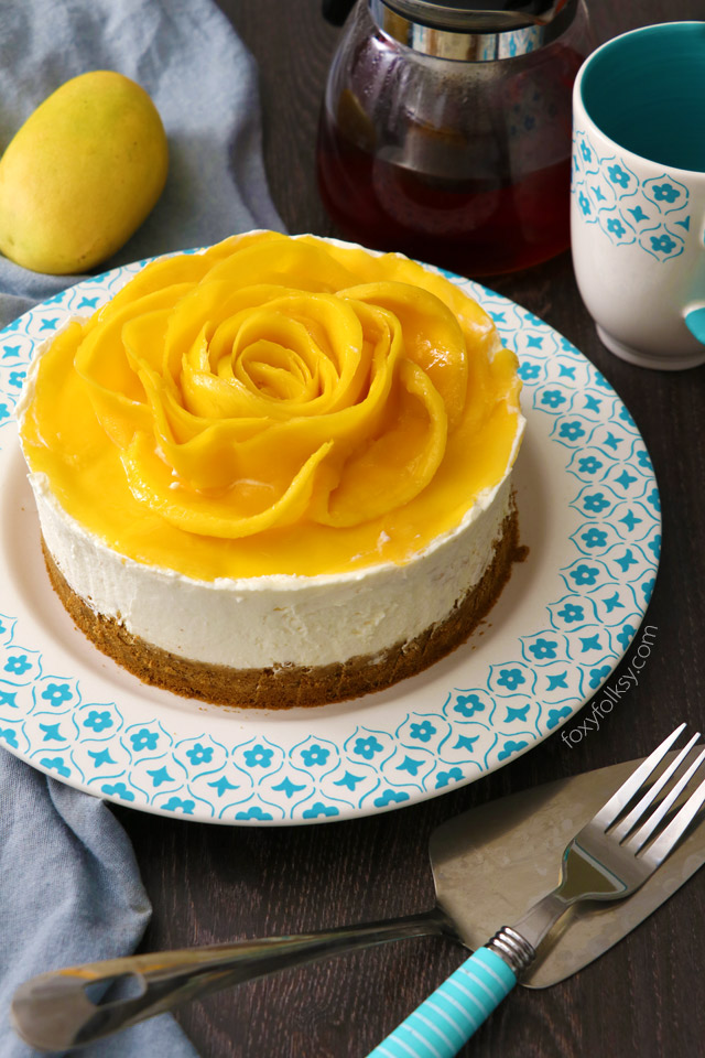 This No-Bake Mango Cheesecake is probably the easiest cheesecake recipe I've done. Mildly sweetened to enhance the natural flavors. Try it now! | www.foxyfolksy.com