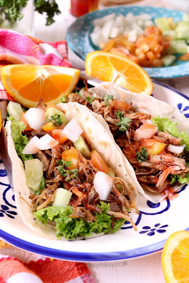 Bring your taco nights to the next level with this Pork Carnitas Tacos recipe. Soft, freshly made tortillas and savory, spicy Pork Carnitas, combined with your favorite taco veggies. Delicious! | www.foxyfolksy.com