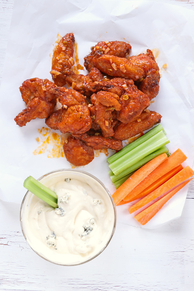 crispy fried buffalo wings with dip and celery and carrot sticks