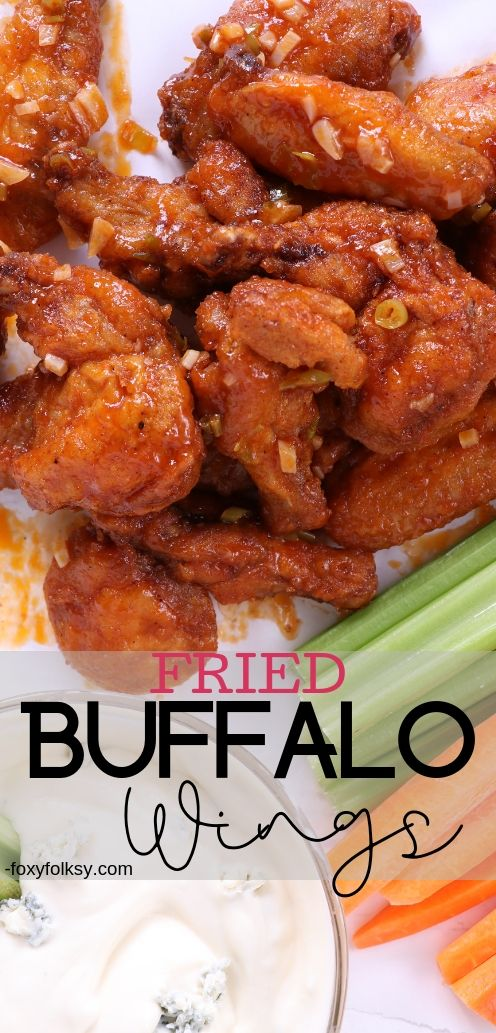 This simple recipe of buffalo wings will surely blow yourminds. Super crispy fried buffalo wings with spicy buttery sauce and a tangy blue cheese to dip it with. Definitely delicious! | www.foxyfolksy.com #spicy #chickenrecipe #foxyfolksy #appetizer #snack