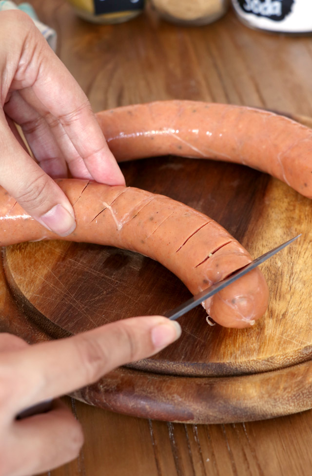 cutting sausages