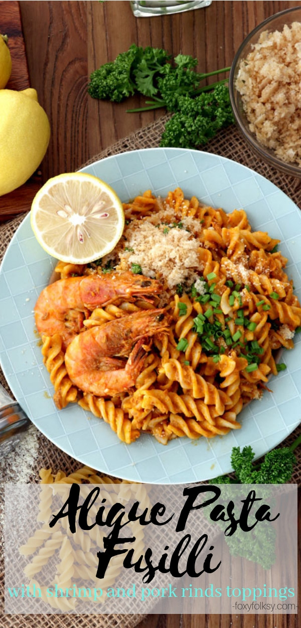 Try this special Aligue Pasta made with fusilli pasta tossed in a thick, creamy sauce of crab fat, cream and lemon juice then topped with shrimps and crushed  chicharon (pork rinds). | www.foxyfolksy.com #pasta #seafood #Filipino #pinoyfood #crab #shellfish