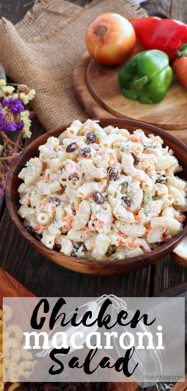 Try this chicken macaroni salad that is loaded with shredded chicken, onions, carrots, and bell peppers and a sweet surprise from raisins and pineapple.| www.foxyfolksy.com #macaroni #salad #chicken #sidedish #snack #pasta #christmas
