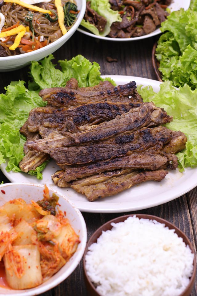 Korean BBQ Short Ribs or Galbi served on a plate with side dishes
