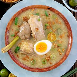 Arroz Caldo or Filipino Chicken Rice Porridge in a bowl.