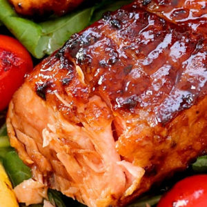 Pan-seared Honey Glazed Salmon with crispy charred edges and juicy center.