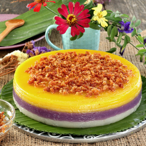 Filipino Sticky Rice Cake with 3 layers, white, violet and yellow.