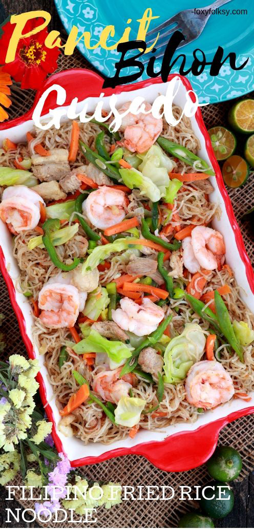 Try this easy Pancit Bihon recipe, an all-time favorite Filipino fried noodles dish made from rice vermicelli, shrimps, pork and mix of vegetables.  Popularly served at birthdays and on every special occasion! | www.foxyfolksy.com #recipe #filipinofood #noodles #foxyfolksy