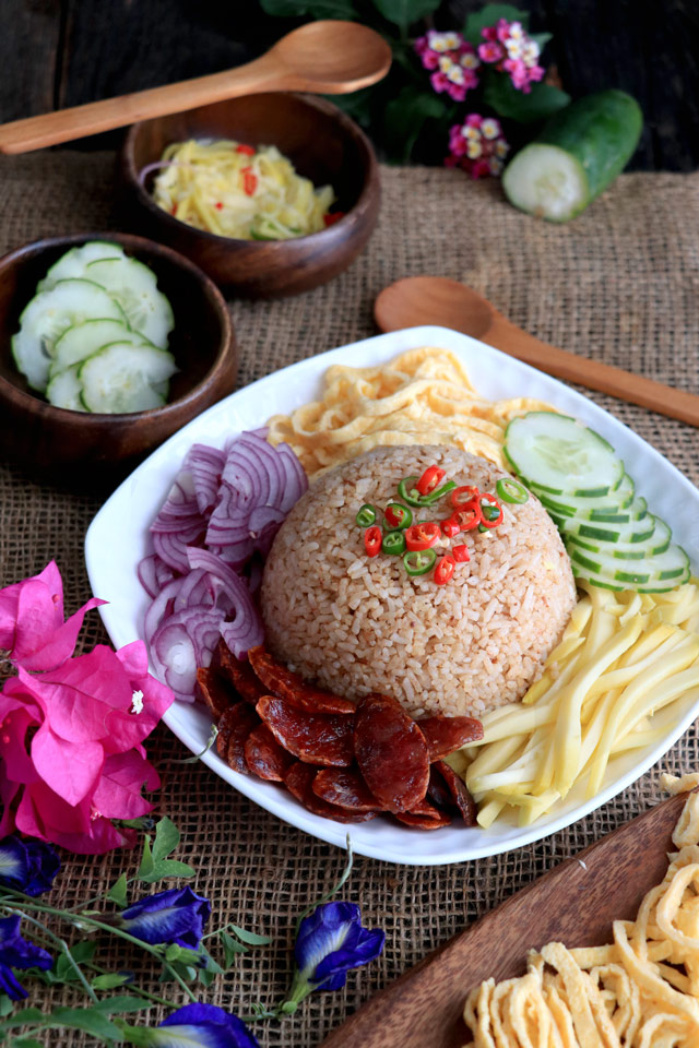 Thai Rice with shrimp paste and sides: green mango, red onions, shredded omelette, cucumber and Chinese sausage