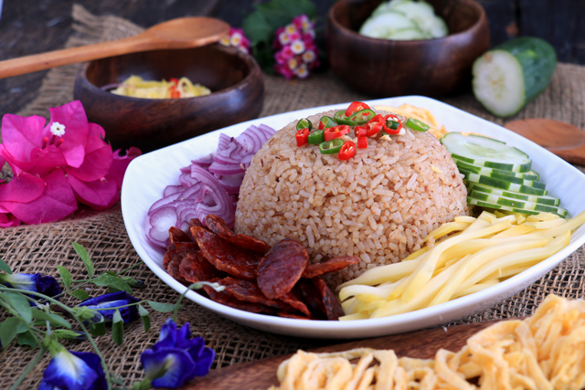 Thai Rice with shrimp paste and sides: green mango, red onions, egg, cucumber and Chinese sausage
