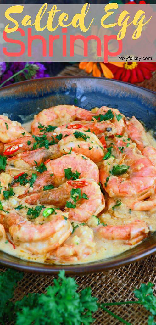 Sink your teeth in some plump, juicy, sweet shrimp cooked in spicy creamy, rich, and savory salted egg sauce. | www.foxyfolksy.com #shrimp #seafood #saltedegg #asiandishes #singaporefood #foxyfolksy