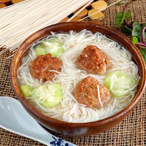Meatballs and noodles soup.