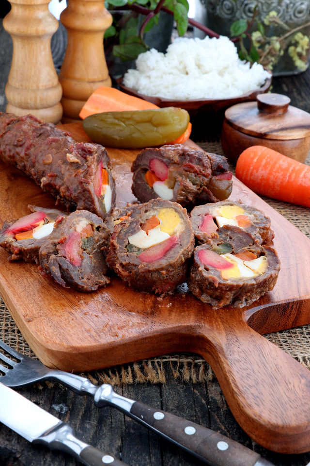 Morcon - beef roll stuffed with hard-boiled egg, pickle, carrots and cheese