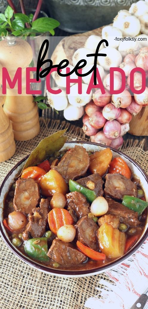 Mechado is a Filipino tomato-based braised beef with savory-tangy flavors from calamansi and soy sauce. Traditionally made using leaner and inexpensive cuts of beef larded with pork fat to keep it juicy and more flavorful. | www.foxyfolksy.com #beefrecipe #filipinorecipe #filipinofood #recipes #foxyfolksy