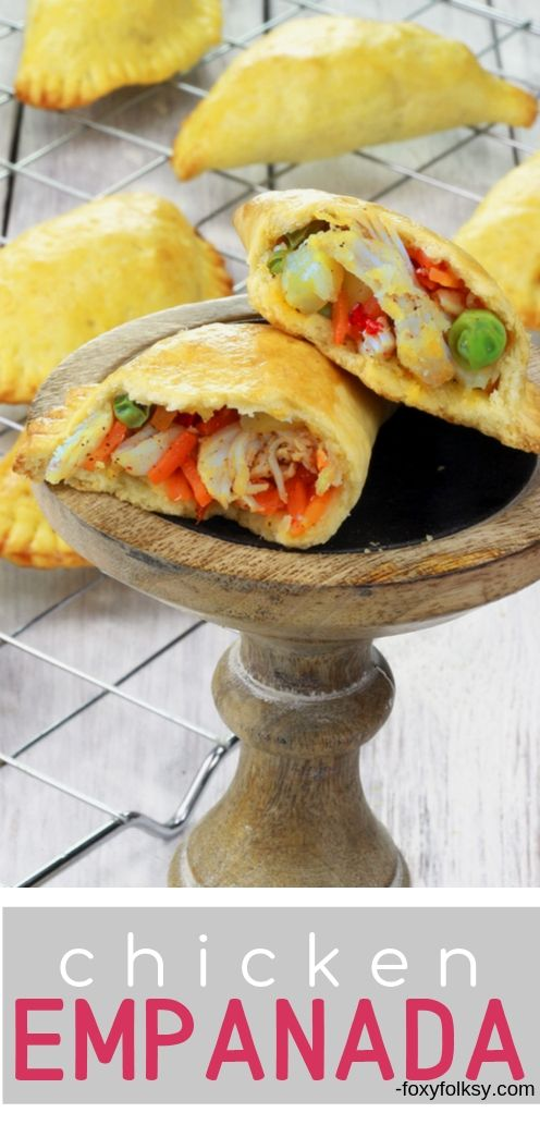 This Filipino chicken empanada is packed with flavorful filling of shredded chicken, potatoes, carrots, peas and raisins. Enclosed in a mildly sweet flaky pastry that is baked to golden crispy perfection. | www.foxyfolksy.com #empanada #turnover #filipinorecipe #chicken #snack