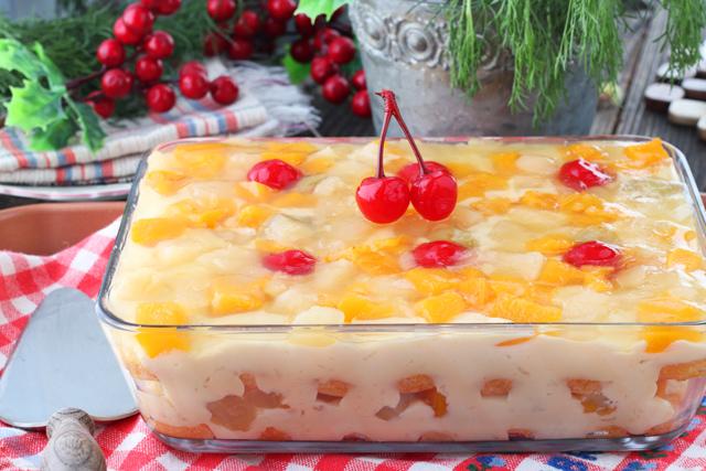 Crema de Fruta- layered dessert of cake, custard, fruit cocktail and gelatin.