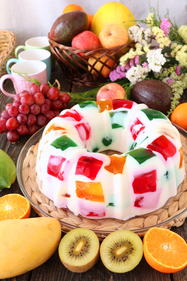 Cathedral Window Dessert with fruits in the background.